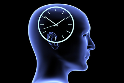 and blue neon side profile of a human head with a analog clock above the ears.