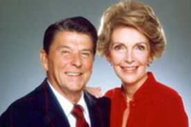President Reagan and Mrs. Ronald Reagan together smiling.